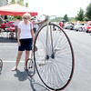 "Donna Cracraft of Zionsville admires antique bicycles Saturday afternoon at Fanimation, 10983 Bennett Pkwy. Cracraft said she's the ""proud owner of a Fanimation fan."" The local business was hosting a National Ceiling Fan Day Awareness Party, complete with a deejay, free food by Edwards Dashboard Diner, a beer garden, root beer floats, caricaturist, kids' activities, classic car show, antique bicycles, and prize giveaways. The Fanimation Antique Fan Museum also was open. Company President Nathan Frampton said one goal of the event was to educate people that fans are good for the environment and the household budget. Company employees are encouraging people to turn off their air conditioning on National Ceiling Fan Day, Sept. 18, and use fans to conserve ""trillions of kilowatt hours of energy."""
