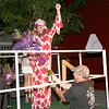 Miss Bubbles, Zionsville Police Officer Josh Chapman, gets doused with sparkling apple cider Friday night, Aug. 9, after winning the high heel/stilleto race during the Z'Sparkle Party and Drag Race.