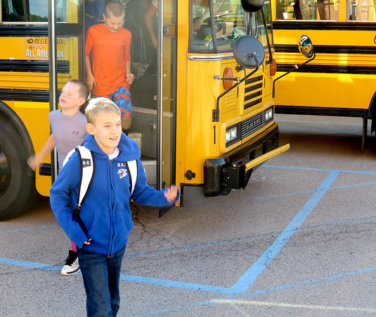 Students come off the bus for the first time Wednesday morning, Aug. 14, at Boone Meadow Elementary School.