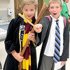 Matthew Hansen, 9, and Stuart Buttars, 10, show off their wizardry Wednesday afternoon, July 31, during a Harry Potter birthday party at Hussey-Mayfield Memorial Public Library. Children were sorted into houses from the popular children's book series and learned more about witchcraft and wizardry.