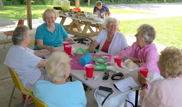 """A group of Zionsville women enjoy food and conversation Friday afternoon, July 26, outside Town Hall. Marilyn Rickard, Elaine McVay, Roberta Martin, Anne Loomis and Mary Moreland were among the crowd that celebrated the one year anniversary of Boone County Senior Services, Inc., having a Zionsville office.<br /> Anita Bowen, executive director of BCSSI, said the Zionsville office has been doing very well since it opened last July. Bowen said opening a Zionsville office was important for BCSSI.<br /> """"We wanted to make sure we were serving this part of the county,"""" she said. """"At BCSSI, we are all about serving the entire county and offering programs in different parts of the community.""""<br /> Bowen said the office at Town Hall, 1100 W. Oak St., will now be open from 9 a.m. to 4 p.m. Wednesdays and Fridays."""