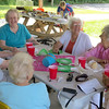 "A group of Zionsville women enjoy food and conversation Friday afternoon, July 26, outside Town Hall. Marilyn Rickard, Elaine McVay, Roberta Martin, Anne Loomis and Mary Moreland were among the crowd that celebrated the one year anniversary of Boone County Senior Services, Inc., having a Zionsville office.<br /> Anita Bowen, executive director of BCSSI, said the Zionsville office has been doing very well since it opened last July. Bowen said opening a Zionsville office was important for BCSSI.<br /> ""We wanted to make sure we were serving this part of the county,"" she said. ""At BCSSI, we are all about serving the entire county and offering programs in different parts of the community.""<br /> Bowen said the office at Town Hall, 1100 W. Oak St., will now be open from 9 a.m. to 4 p.m. Wednesdays and Fridays."