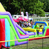 Families meander through the bouncey-house area at the 2013 Zionsville Fall Festival Saturday, Sept. 7.