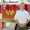 Whitestown Fire Chief Josh Westrich poses in front of a fire truck Wednesday evening, July 24. Westrich was appointed by the Whitestown Town Council as the new fire chief Wednesday evening.
