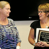 Rod Rose The Lebanon Reporter<br /> Nancy Busenbark, who retired this spring after  34-year teaching career with the Western Boone County Community School Corp., is presented a plaque by Superintendent Dr. Judi Hendrix Monday.