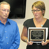 Rod Rose The Lebanon Reporter<br /> Western Boone Community School Corp. Superintendent Dr. Judi Hendrix presents former teacher Danny Pierce a plaque commemorating his 35-year career with the school district.