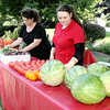 Rod Rose The Lebanon Reporter<br /> Sonja Coffey (left) and Sarah Coffey, both of Lebanon, ready the Becky's Market booth at the Lebanon Farmer's Market Thursday afternoon in Memorial Park. All the produce is grown at their Lebanon farm. Becky's Market, in business since 1968, provides all the produce for the Beehive restaurant in the Witham Health Services Pavilioni during the Boone County 4-H Fair.