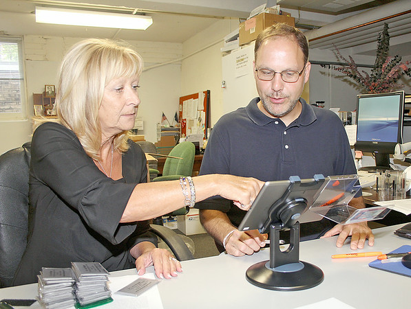 Rod Rose The Lebanon Reporter<br /> Boone County Clerk Penny Bogan and Andrew Wood, deputy clerk for elections, demonstrate how voters will register at the polls this November using the new epoll book system.