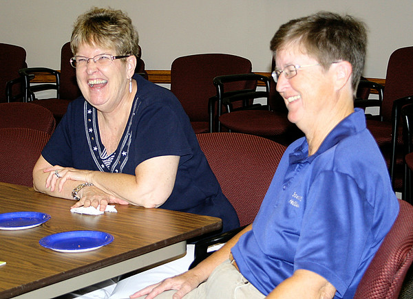 Rod Rose The Lebanon Reporter<br /> Pat Minnick (right) and her sister, Jackie Fowler, share a joke during Friday's open house commemorating Minnick's retirement from the Boone County Health Department.