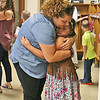 FIRST DAY OF SCHOOL<br /> Elizabeth Pearl | The Lebanon Reporter<br /> BACK TO CLASS: Felicia Hitch, left, hugs her daughter Lucy Hitch Tuesday morning at Harney Elementary School. Tuesday was the first day of school for Harney and all Lebanon and Western Boone schools. Felicia Hitch said that while she was used to seeing her daughter, a kindergardener, go to school, she wasn't yet used to the longer school day.