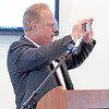 Rod Rose The Lebanon Reporter<br /> PANORAMA: Gerry Dick opens his keynote speech at Monday morning's Boone County Economic Development Corp. annual meeting by taking a photo of the audience.