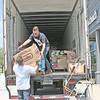 "FLOOD RELIEF: <br /> Elizabeth Pearl | The Lebanon Reporter<br /> DONATED GOODS: Freedom Church lead pastor Ryan Vinson, top, and congregation member Craig Parks loaded boxes of donated goods into a semi-truck outside the church Friday afternoon. The semi-truck, donated by Sheridan-based company JBS United, will be driven to Baton Rouge next Monday or Tuesday, and the items inside given to people impacted by the recent floods. <br /> Vinson spent time in the city and maintains a relationship with Baton Rouge's Bethany Church. Freedom sent money already to help Bethany, whose facilities were damaged in the floods, but Vinson said he wanted to do more. <br /> ""As soon as we heard that they were heavily involved, it made the decision to do this so much easier,"" he said. ""We know this stuff is going to be in good hands."" <br /> The church is accepting donations through Sunday, with a goal of filling the truck before it leaves on the long trip to New Orleans. Among the items needed are hygiene products, clothing, baby supplies, cleaning products and construction items like hammers, shovels and work gloves. <br /> Donations will be accepted Saturday between 10 a.m. and 4 p.m. and Sunday between 1 p.m. and 5 p.m. at the church, located at 2061 Indianapolis Ave. For more information, go online to  <a href=""http://www.welcometofreedom.church"">http://www.welcometofreedom.church</a> or call 765-482-7220."