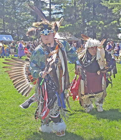 POW WOW BACK IN BOONE<br /> Elizabeth Pearl | The Lebanon Reporter<br /> RETURN TO TRADITION: Performers at the 34th annual Traditional Pow Wow do a dance in full regalia Sunday. The Pow Wow was held at the Boone County 4-H Fairgrounds this weekend. In addition to the dance, the event featured a Native trade market and food.