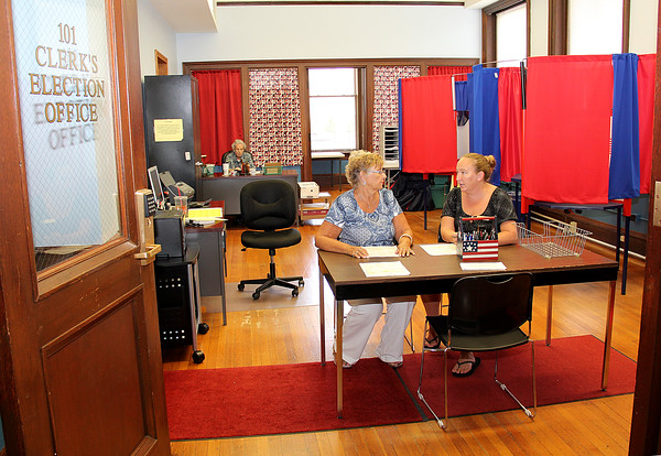 Rod Rose The Lebanon Reporter<br /> ELECTION DIVISION MOVES: Boone County Clerk Jessica Fouts (right) and election deputy clerk Hazel Johnson discuss plans for the upcoming general election, as election clerk Jean Caldwell (background) sorts through files, in the new election office on the first floor of the Boone County Courthouse.