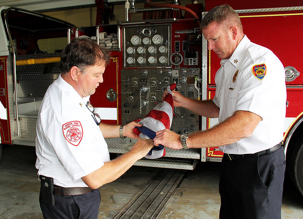 Rod Rose The Lebanon Reporter<br /> FLAG DISPOSAL: Center Township Fire Chief Mike Spidel (left) and Lebanon Fire Chief Chuck Batts fold an American flog in prepartion for its proper disposal.