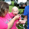 Starting Early: Grandparents Mark and Lora Woodard help feed their 19-month-old granddaughter Rhyanna Harris during Saturday's Battle of the BBQ at Memorial Park. Harris kept signing for more BBQ as the contest began to wind down.
