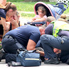 "Child Taken To Riley Hospital After Traffic Accident<br /> By Jake Thompson<br /> Emotional Moment: Hope Peters (left) is overcome with emotion as rescue workers attend to her son, Trevor Esterline, 6, in the early afternoon Friday in the 500 block of N. Lebanon St. Three witnesses said the boy darted from his mother and ran into the side of a silver Mitsubishi Mirage headed north, driven by 16-year-old Kindsey Robertson, Lebanon Police Lt. Scott Hood said. The car's right front quarterpanel took damage and the windshiled was cracked following the collision. ""He went airborne and looked like he folded in half,"" said witness Pauletta Cooley. ""I thought a car hit a dog."" Hood said LPD officer Taylor Nielsen reported the boy was not conscious when she arrived. Esterline then ""snapped"" out of it, Hood said, and became conscious as medical personnell began to attend to him. The boy and mother were transported to Riley Children's Hospital in Indianapolis."