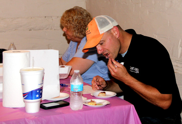 Good Eats: Battle of the BBQ judges Ryan West, owner of St. Adrian Meats and Sausage, and Melody Fry judge the hot/spicy category at Saturday's Battle of the BBQ at Memorial Park.