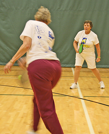 "IN A PICKLE<br /> Elizabeth Pearl | The Lebanon Reporter<br /> PICKLISH PLAY: Claudia McCracken (right) watches as teammate Camilla Bowman hits a whiffle ball back to the other side of the net in a game of pickle ball on Wednesday afternoon at the Witham Family YMCA. The sport was added this year as part of the Boone County Senior Services Olympics. Similar to tennis and badminton, it involves hitting a green whiffle ball back and forth, until the winning team scores 11 points. Though McCracken and Bowman lost 11-10 to opponents Ken and Vicki Carr, both said they enjoyed the sport. <br /> Vicki Carr said she'd never played before but had a great time. <br /> ""It was very fun,"" she said. ""And winning makes it more fun.""<br /> Several seniors had suggested the sport after last year's Olympics, said BCSSI executive director Anita Bowen. The YMCA already had a league and gave lessons, so they decided to go ahead. Sixteen seniors signed up to play pickle ball this year."