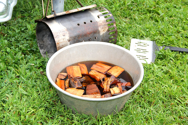 Necessary Equipment: Teams came early and endured the rai during the 2016 Battle of the BBQ event. Soaked wood chips, charcoal starter and spatula's were just a few tools of the trade for multiple teams.