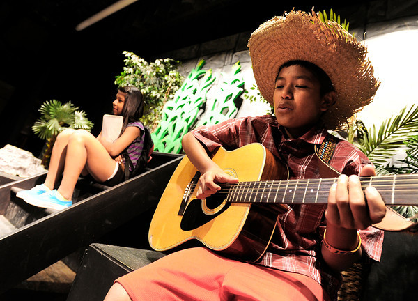Seventh-grader Edit Morquecho, left, and sixth-grader Carlos Arias rehearse a stage adaptation of Laura Resau's book What The Moon Saw during Resau's visit to the school on Thursday, April 26, at Manhattan Middle School of Arts and Academics in Boulder. For a video of <br /> Jeremy Papasso/ Camera