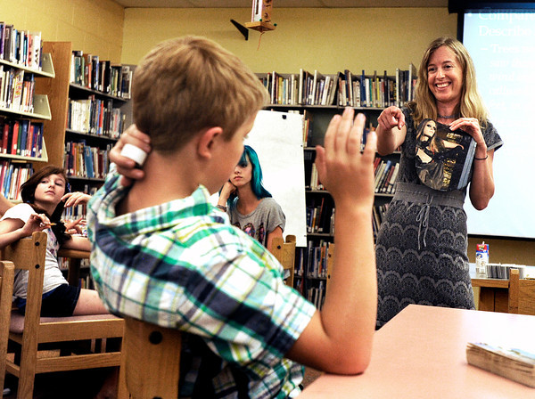 Author Laura Resau, right, calls on sixth grade student Miles Hughes to listen to his interpretation of a picture during Resau's writing workshop on Thursday, April 26, at Manhattan Middle School of Arts and Academics in Boulder. For a video of <br /> Jeremy Papasso/ Camera