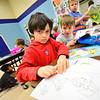 "KRISTOPHER RADDER — BRATTLEBORO REFORMER<br /> Jasper Connolly, a first grader at NewBrook Elementary School, works on a drawing of a dog as the author of ""Adventures of Turbo,"" Alexia Pearson, visited the school on Tuesday, Jan. 29, 2019."
