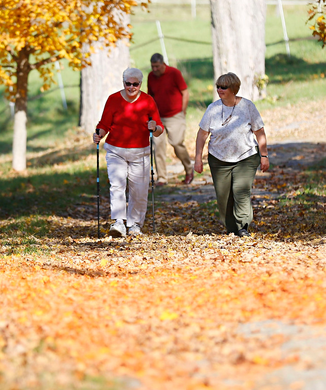 . Holly Pelczynski - Bennington Banner Nancy Osgood, and Nan Lance  take a walk on the mile woods trail in North Bennington on Tuesday afternoon.