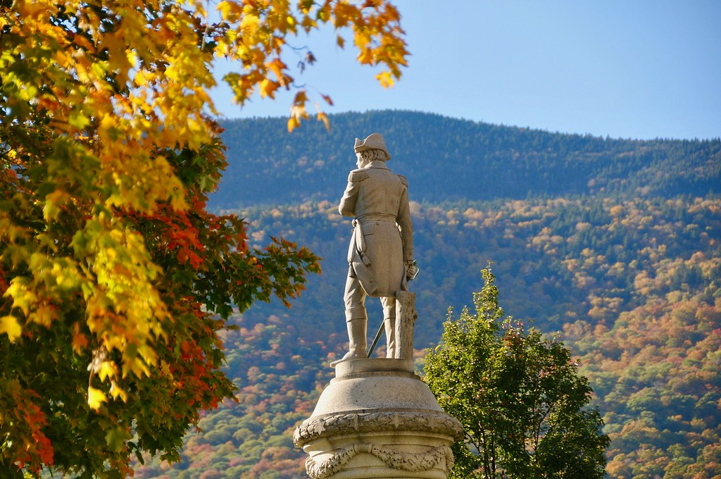 . The memorial to Manchester men who served in the The Revolutionary War, the War of 1812, The Mexican War and the Civil War overlooks fall foliage. Wednesday, Oct. 19, 2016. Scott Stafford � The Manchester Journal