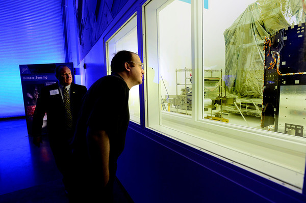 "Jeff Dirks, World View 3 Program Manager gives Congressman Jared Polis a rundown on the satellite seen in a clean room during a tour of a new 90,000-square-foot facility expansion at the Ball Aerospace Fisher Integration Facility in Boulder on Friday January 25, 2013. The World View 3 satellite is being built for Longmont's  DigitalGlobe.<br /> For more photos go to  <a href=""http://www.dailycamera.com"">http://www.dailycamera.com</a><br /> Photo by Paul Aiken"