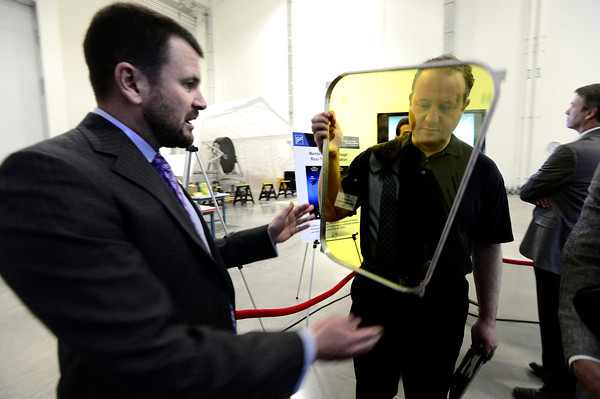 """Jeff Kommers, MOIRE Program Manager gives Congressman Jared Polis, right, a new light weight membrane that will be used in the optical system of large telescopes during a tour of a new 90,000-square-foot facility expansion at the Ball Aerospace Fisher Integration Facility in Boulder on Friday January 25, 2013. The new membranes are being developed to replace current technology at a much lower cost. <br /> For more photos go to  <a href=""""http://www.dailycamera.com"""">http://www.dailycamera.com</a><br /> Photo by Paul Aiken"""