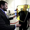 "Jeff Kommers, MOIRE Program Manager gives Congressman Jared Polis, right, a new light weight membrane that will be used in the optical system of large telescopes during a tour of a new 90,000-square-foot facility expansion at the Ball Aerospace Fisher Integration Facility in Boulder on Friday January 25, 2013. The new membranes are being developed to replace current technology at a much lower cost. <br /> For more photos go to  <a href=""http://www.dailycamera.com"">http://www.dailycamera.com</a><br /> Photo by Paul Aiken"