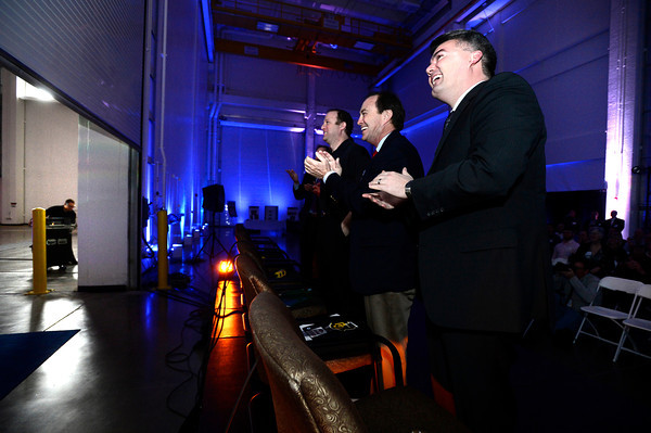 "Colorado congressmen, from left to right Jared Polis, Ed Perlmutter and Cory Gardner, watch the rising door of a 90,000-square-foot facility expansion during a celebration of the new space at the Ball Aerospace Fisher Integration Facility in Boulder on Friday January 25, 2013.<br /> For more photos go to  <a href=""http://www.dailycamera.com"">http://www.dailycamera.com</a><br /> Photo by Paul Aiken"