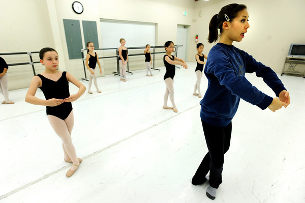 "Instructor Michelle Vagi demonstrates a routine while student Austin Price, left looks on at Ballet Nouveau on Monday December 5, 2011. Ballet Nouveau in Broomfield is one of dozens of Boulder and Broomfield county groups that are recipients of the proceeds of Colorado Gives Day. A number of students in the school receive scholarships from the fund. For more photos of the class go to  <a href=""http://www.dailycamera.com"">http://www.dailycamera.com</a><br /> Photo by Paul Aiken / The Camera"