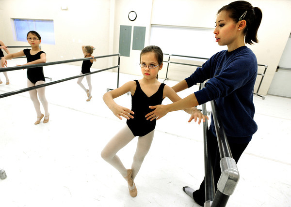 "Instructor Michelle Vagi works with student Fiona Baldwin on her posture at Ballet Nouveau on Monday December 5, 2011. Ballet Nouveau in Broomfield is one of dozens of Boulder and Broomfield county groups that are recipients of the proceeds of Colorado Gives Day. A number of students in the school receive scholarships from the fund. For more photos of the class go to  <a href=""http://www.dailycamera.com"">http://www.dailycamera.com</a><br /> Photo by Paul Aiken / The Camera"
