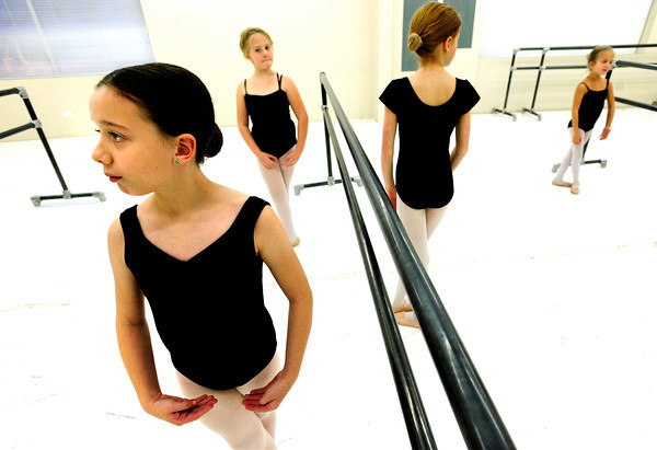 "Austin Price, front left, holds a ready pose as students at Ballet Nouveau wait to perform a section of dance on Monday December 5, 2011. With Price from left to right are students Anne Soeth, Ashley Miller, and Gracia Vought.  Ballet Nouveau in Broomfield is one of dozens of Boulder and Broomfield county groups that are recipients of the proceeds of Colorado Gives Day. A number of students in the school receive scholarships from the fund. For more photos of the class go to  <a href=""http://www.dailycamera.com"">http://www.dailycamera.com</a><br /> Photo by Paul Aiken / The Camera"