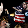 "Don Reade, 20, of Long Island, N.Y., cheers with hundreds of people, many fellow students from George Washington University, as they gather by the White House in Washington early Monday, May 2, 2011, to cheer the United States after President Barack Obama announced that Osama bin Laden had been killed. ""I'm a New Yorker so this is a really big deal to me,"" said Reade. (AP Photo/Jacquelyn Martin)"