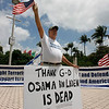 Bob Kunst from Shalom International celebrates the news of the death of Osama bin Laden at the Torch of Freedom, Monday, May 2, 2011, in Miami. (AP Photo/Jeffrey M. Boan)