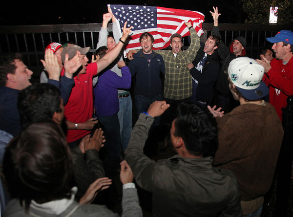 After the death of Osama Bin Laden  is announced, people gathered outside of the the gated Dallas neighborhood of former U.S. President George W. Bush on the morning of Monday, May 2, 2011. (AP Photo/The Dallas Morning News, Nathan Hunsinger)  MANDATORY CREDIT; NO SALES; MAGS OUT; TV OUT