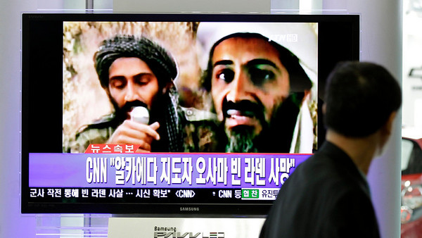 "A man watches a TV broadcast on the death of Osama bin Laden at Seoul train station in Seoul, South Korea, Monday, May 2, 2011. Osama bin Laden, the glowering mastermind behind the Sept. 11, 2001, terror attacks that killed thousands of Americans, was killed in an operation led by the United States, President Barack Obama said Sunday. The Korean read: ""Death, Osama bin Laden."" (AP Photo/Lee Jin-man)"