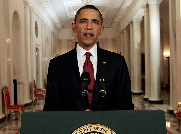 President Barack Obama reads his statement to photographers after making a televised statement on the death of Osama bin Laden from the East Room of the White House in Washington, Sunday, May 1, 2011.  (AP Photo/Pablo Martinez Monsivais)