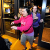 """Susan Yang is one of the first to burst through the open doors of FlatIron Crossing Mall as the shopping center opened at midnight in Broomfield for the traditional start of the holiday shopping season.<br />  November 25, 2011. For more photos and a video of Black Friday go to  <a href=""""http://www.dailycamera.com"""">http://www.dailycamera.com</a><br /> Photo by Paul Aiken / The Camera"""
