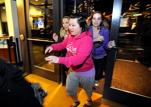 "Susan Yang is one of the first to burst through the open doors of FlatIron Crossing Mall as the shopping center opened at midnight in Broomfield for the traditional start of the holiday shopping season.<br />  November 25, 2011. For more photos and a video of Black Friday go to  <a href=""http://www.dailycamera.com"">http://www.dailycamera.com</a><br /> Photo by Paul Aiken / The Camera"