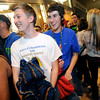 """Zane Carkeek, left and John Shannon, show their happiness of getting in line at a store at the FlatIron Crossing Mall as the shopping center opens at midnight in Broomfield for the traditional start of the holiday shopping season. The first 100 people in line at this store will receive a $100 gift card.For more photos and a video of Black Friday go to  <a href=""""http://www.dailycamera.com"""">http://www.dailycamera.com</a><br />  November 25, 2011.<br /> Photo by Paul Aiken / The Camera"""