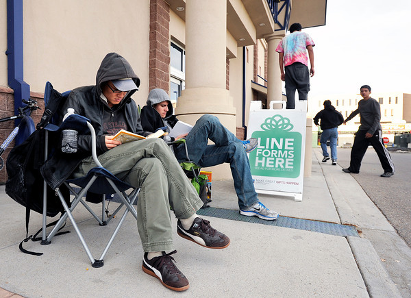 "Black Friday Shopping001.JPG Unjung Whang, of Boulder, left, and Matt Laszlo, of Boulder, center, read books while waiting in line for the Black Friday sales on Thursday, Nov. 24,  at Best Buy on 30th Street in Boulder. Laszio was first in line and Whang was second. For a video of the early shoppers go to  <a href=""http://www.dailycamera.com"">http://www.dailycamera.com</a><br /> Jeremy Papasso/ Camera"