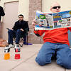 """Black Friday Shopping002.JPG Balmukund Adhikari, of Erie, looks for the good deals in a Best Buy catalog while waiting in line for the Black Friday sales on Thursday, Nov. 24,  at Best Buy on 30th Street in Boulder. For a video of the early shoppers go to  <a href=""""http://www.dailycamera.com"""">http://www.dailycamera.com</a><br /> Jeremy Papasso/ Camera"""