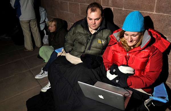 black friday0015.JPG Scott Edwards, left, and Becca Kershaw watch Fight Club on their laptop while waiting in line for Black Friday at Best Buy in Boulder on Thursday Nov. 22, 2012. DAILY CAMERA/ JESSICA CUNEO. They arrived in line at 6 pm on Thanksgiving day.