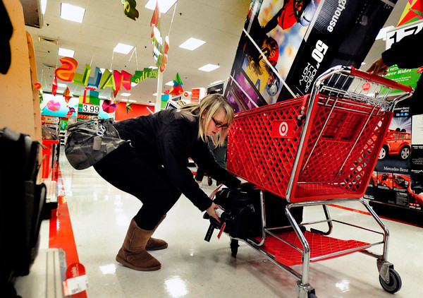 black friday target0123.JPG Allyson Kerns grabs a suitcase after getting a TV during Black Friday at Target in Boulder on Thursday Nov. 22, 2012. DAILY CAMERA/ JESSICA CUNEO.