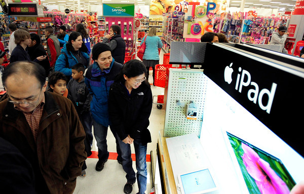 black friday target0223.JPG Yee Chan, right, and Mawder Foo wait for more ipads to be stocked during Black Friday at Target in Boulder on Thursday Nov. 22, 2012. DAILY CAMERA/ JESSICA CUNEO.