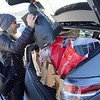BEN GARVER — THE BERKSHIRE EAGLE<br /> Tammy Stine  from South Hampton, Mass., puts the final bags from her haul at Prime outlets in Lee to their rather full SUV.
